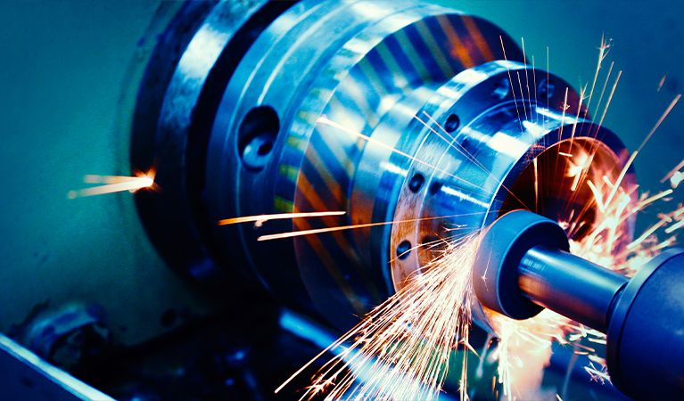 Close-up of a CNC machine being used with sparks flying around it.jpg